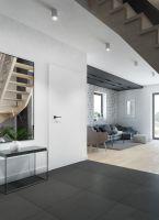 Przestrzeń dzienna w jednorodzinnym domu - widok z przedpokoju na część wypoczynkową. Projekt i wizualizacje: Magdalena Miszczyk-Tatara.