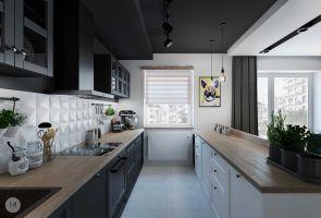 Białe płytki z efektem 3D pięknie kontrastują z grafitową zabudową kuchni. Projekt i wizualizacje: Magdalena Miszczyk-Tatara.