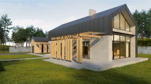 Użyte w projekcie drewno i blacha idealnie współgrają betonem.