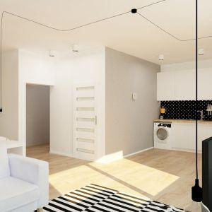 Jedną z ważniejszych kwestii, z jaką zmierzył się projektant, było wydzielenie poszczególnych stref. Z uwagi na mały metraż mieszkania, zastosowanie ścianek działowych nie wchodziło w grę. Fot. aledesign.pl