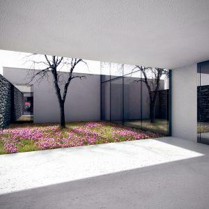 Mur i część elewacji tworzy niewielki wewnętrzny dziedziniec. Dom za murem. Projekt Architekci: KLUJ ARCHITEKCI /www.kluj.com.pl. Fot. Kluj Architekci