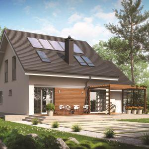 Ze względu na funkcję chroniącą budynek przed przegrzaniem w lecie pergola jest chętnie stosowana przez projektantów domów energooszczędnych. Projekt: Leosia G1 Energo. Fot. Archipelag