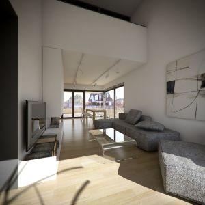Dzięki dużym przeszkleniom przestrzeń dzienna jest bardzo dobrze doświetlona. Wnętrza utrzymano w jasnej stonowanej kolorystyce i nowoczesnym stylu. Fot. Kluj Architekci