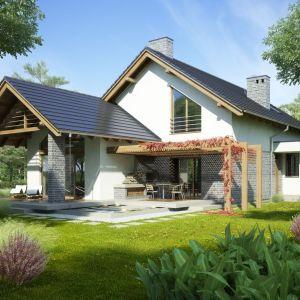 Na ogrzewanie zużywamy ponad 70% energii pobieranej na potrzeby funkcjonowania gospodarstw domowych, dlatego warto zainwestować w dom energooszczędny. Proj. Alex, Fot. Dobre Domy