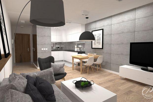 Właściciele tego mieszkania zdecydowali się, ufając architektom z pracowni Progetti Architektura, na aranżację wnętrza w stylu nowoczesnym. Mimo, że wnętrze zostało zdominowane przez barwy białą i szarą, kompozycja architektoniczna nie przyt�