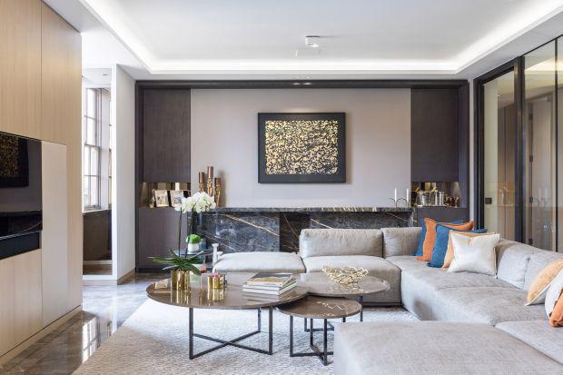 Dobra jakość materiałów, powiększenie strefy dziennej i nadanie wnętrzom bardziej współczesnego charakteru. To na to położyli największy nacisk architekci modernizujący to niemal stuletnie mieszkanie.