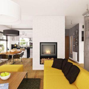 Salon z kuchnią i jadalnią tworzą jedną otwartą przestrzeń. To dobre rozwiązanie, zwłaszcza w niewielkich domach. Hary I ma niecałe 130 metrów kwadratowych powierzchni użytkowej. Fot. Prestige
