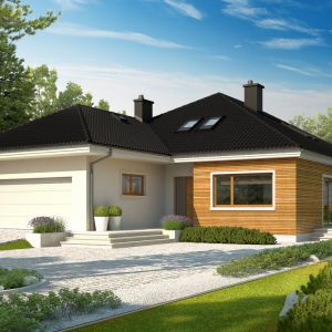 Niezwykle efektownie prezentuje się w połączeniu z drewnem i szkłem. Popularna jest również zabawa kolorem tynku – to ciekawe rozwiązanie jest szczególnie polecane inwestorom, którzy dysponują ograniczonym budżetem na budowę i wykończenie domu. Fot. Archipelag