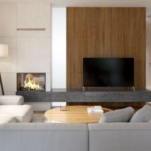 W tym nowoczesnym salonie dominuje kolor biały ocieplony drewnem. Fot. HomeKONCEPT