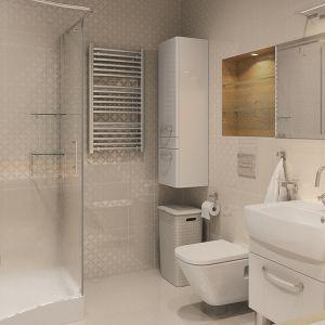 Łazienka domu Ambrozja również jest utrzymana w białych kolorach. Biała, wzorzysta glazura, biała terakota i meble, srebrna armatura i grzejnik oraz duże lustro na ścianie tworzą jasne, eleganckie wnętrze. Fot. Biuro Projektów MTM Styl