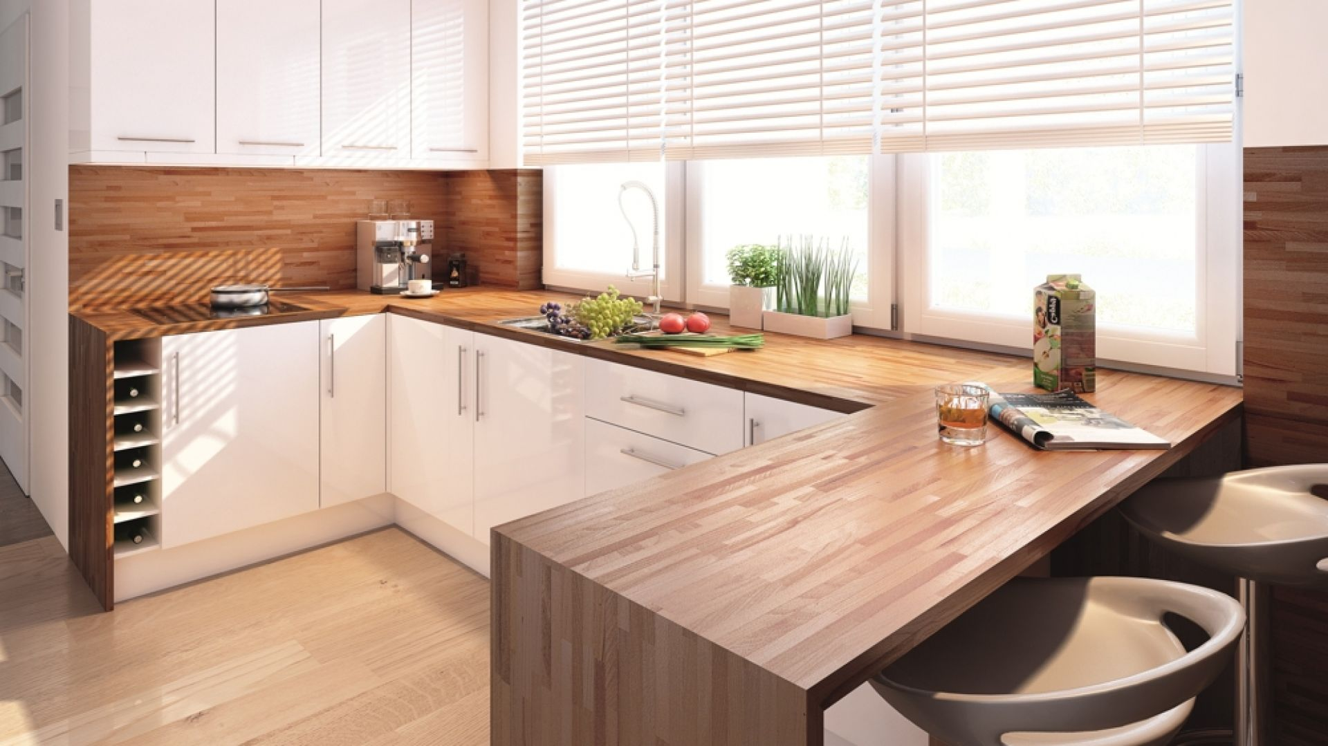 W kuchni domu Ambrozja białe meble, żaluzje, ramy dużych okien ocieplono drewnianym blatem, parkietem i ścianką wokół kuchenki. Fot. Biuro Projektów MTM Styl