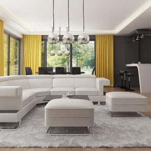 Salon, jadalnia i kuchnia tworzą otwartą strefę dzienną, jakże charakterystyczną dla nowoczesnych wnętrz. Fot. Z500