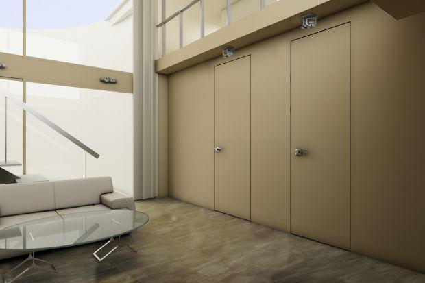 Drzwi i ściana tworzące we wnętrzu jednolitą płaszczyznę? Takie rozwiązanie wygląda bardzo efektownie, a przy tym jest praktyczne i ponadczasowe. Przy tym, nie musi być też kosztowne.