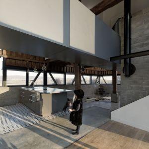 W domu dominuje surowa aranżacja wnętrz. Nawet drewniany strop i belki nie są w tanie ocieplić tego rustykalnego klimatu. Fot. The Barn, David Boureau