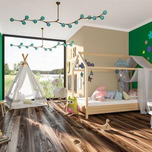 Jednym z pomysłów na aranżację pomieszczenia dla dziewczynek jest stworzenie urokliwego pokoju na wzór komnaty królewny. Fot. Magnat