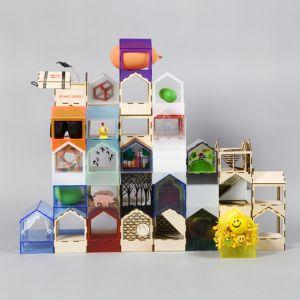 """Architekci ze studia MAKE Architects wykonali """"kawał dobrej roboty"""". Ich domek """"Jigsaw House"""" składa się z 26 w pełni zaprojektowanych domów i dodatkowych 20 pustych domów, które można łączyć ze sobą. Fot. Thomas Butler"""