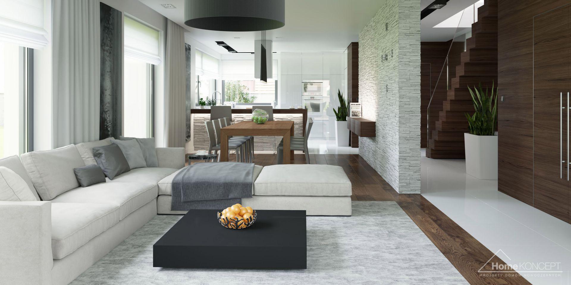 Kuchnia, jadalnia i salon tworzą jedną otwartą przestrzeń dzienną. Fot. HomeKoncept
