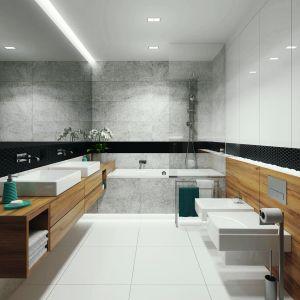 Łazienka została urządzona wmodnych bielach i szarościach. Całość ocieplają duże drewniane powierzchnie. Ściana po stronie umywalek została wykończona lustrem, co optycznie powiększa wnętrze.  Fot. MTM Styl