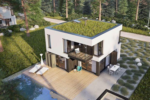 EX 2 Energo Plus to kwintesencja nowoczesnych trendów - prosta energooszczędna bryła, atrakcyjne, drewniane detale elewacji podkreślające surową biel. Płaski dach otwiera dom na nowe możliwości.