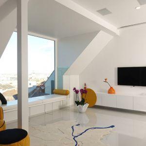 Odświeżenia jego wnętrz podjęli się architekci z Margeza Design Studio. W apartamencie znalazło się miejsce na dwie obszerne sypialnie, które zajmują nie bagatela 110 mkw. całej przestrzeni użytkowej. Fot. Erdőháti Áron