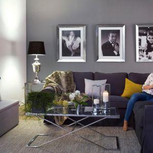 Często, kiedy myślimy o wnętrzu w stylu hygge, mamy przed oczami pomieszczenie w neutralnych, pastelowych kolorach. Jednak przytulność można osiągnąć również za pomocą intensywniejszych barw. Fot. Dekoria.pl