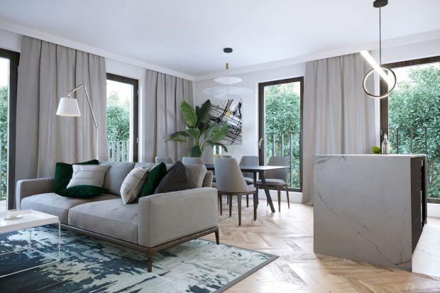 """Ten apartament pasuje do właścicieli jakby został skrojony na miarę: nowoczesny, wyważony, ale z drapieżnym """"pazurem"""", jasny, rozświetlony dużą ilością okien i tafli szkła. Para młodych ludzi wypatrzyła go dla siebie w najgłośniejszym"""