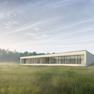 Tylna część domu, otwiera się na jezioro dzięki przeszklonej elewacji budynku. Fot. 81.waw.pl