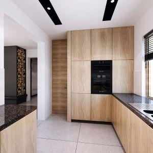 Zamknięta kuchnia jest zaprojektowana bardzo nowocześnie. Fot. Domy w Stylu