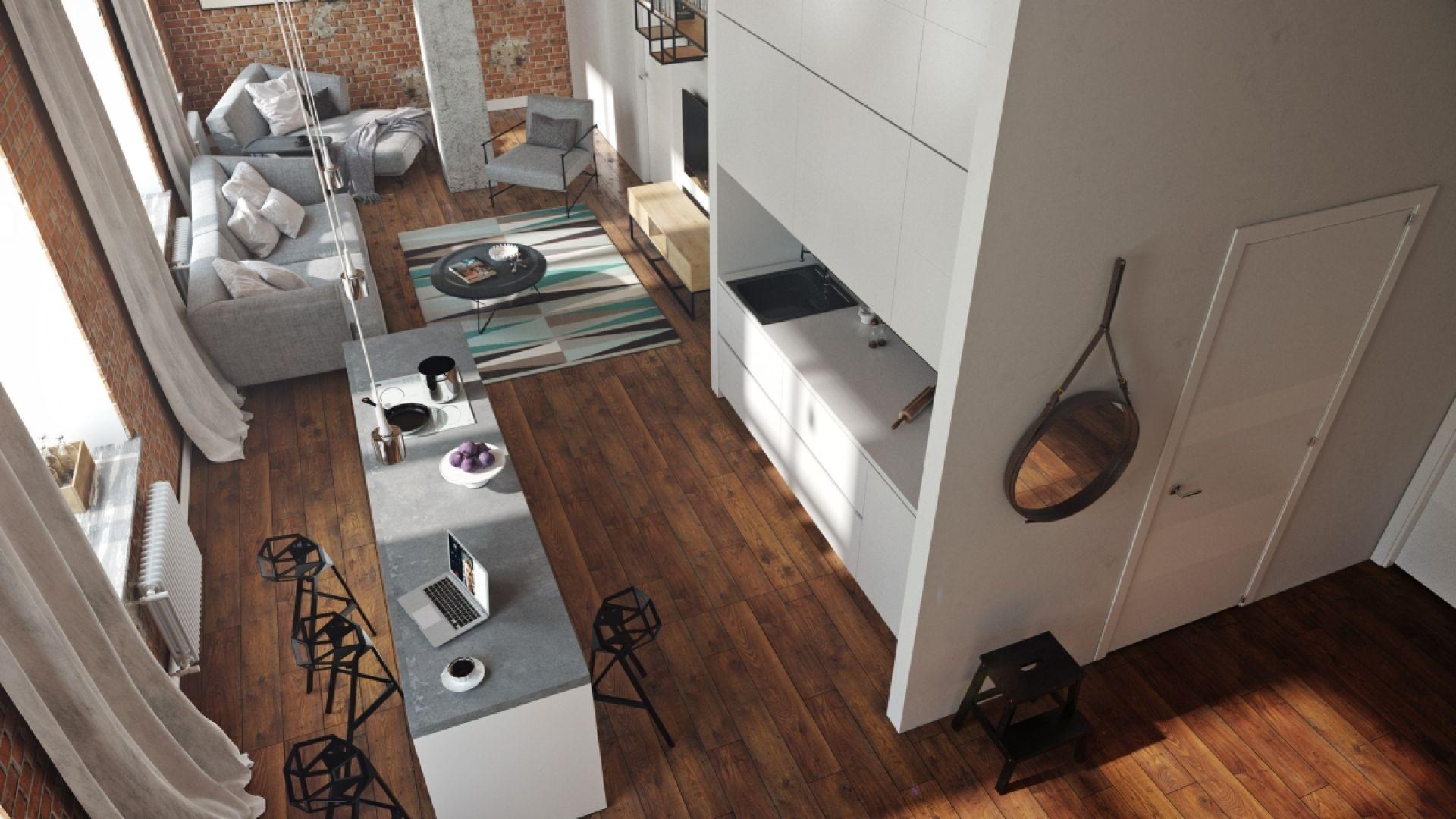 W wysokiej kuchni loftowej bardzo ważne jest oświetlenie. Najlepiej industrialne, surowe, wiszące na kablach. Fot. Nowa Papiernia