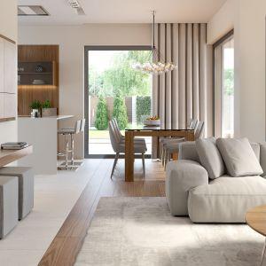 Salon, jadalnia i kuchnia tworzą jedną otwartą przestrzeń dzienną. Fot. HomeKONCEPT