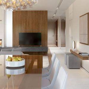 W jadalni centralne miejsce zajmuje prosty stół z drewnianym blatem - ocieplający jasne wnętrze. Fot. HomeKONCEPT