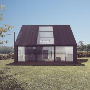 Dla odpowiedniego doświetlenia wnętrza z drugiej strony budynku zastosowano duże przeszklenia, na całą wysokość parteru oraz duży świetlik w dachu. Fot. Malinowski Studio
