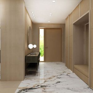 W holu dominuje jasne drewno i szlachetny kamień. Fot. Wyrzykowski Studio