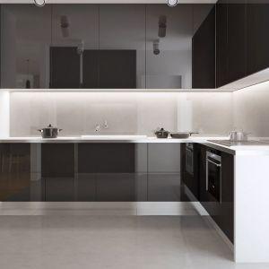 Nieco schowaną kuchnię urządzono w bardzo nowoczesnym, minimalistycznym stylu. Czarno-białe meble nadają wnętrzu elegancji. Fot. Z500