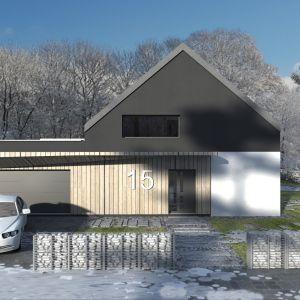 Główna bryła budynku, przekryta dwuspadowym, bezokapowym dachem w połączeniu z dwustanowiskowym garażem o płaskim przekryciu, tworzy nowoczesną architekturę. Fot. Studio BB Architekci