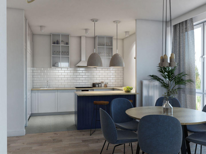 Zabudowa kuchenna w kształcie litery U, uzupełniona o wysoką szafę, jest bardzo pojemna i zapewnia długie, wygodne blaty robocze. Fot. MGN