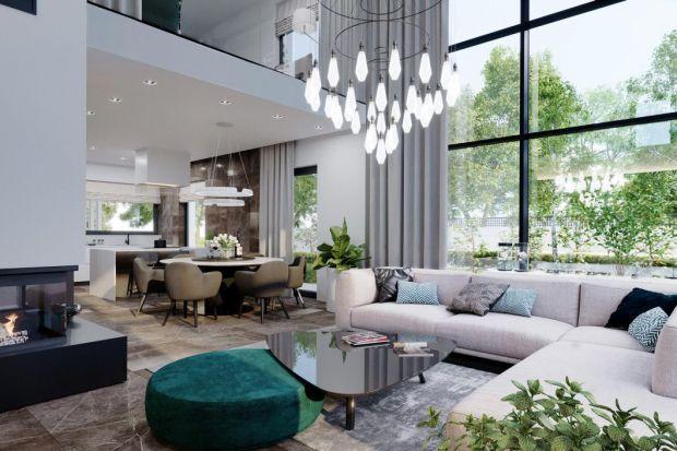 Wnętrza domu HomeKONCEPT 60 to przykład tego, w jaki sposób można nowocześnie, ale jednocześnie przytulnie, urządzić współczesną, piętrową willę. Dużo światła i bieli nadaje całości lekkości i przestronności. Nie brakuje jednak ciemni