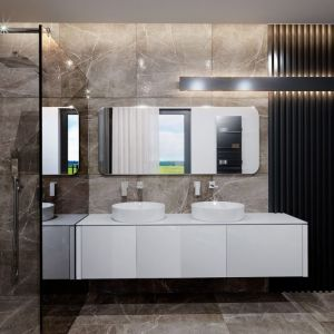 W łazience dominuje brązowy kamień. Stanowi on świetne tło dla białej armatury. Fot. HomeKONCEPT