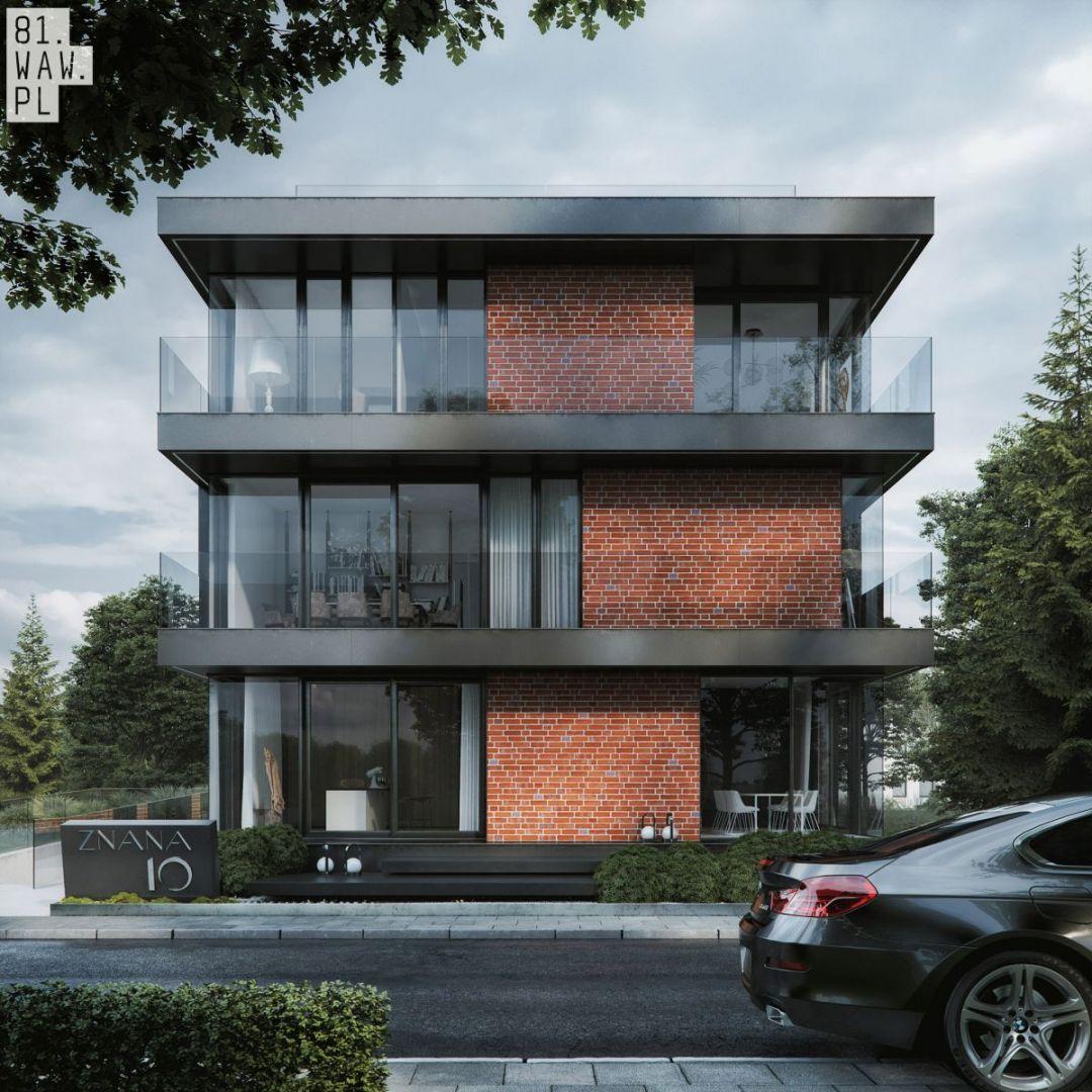 Każda kondygnacja budynku oddzielona jest czarnymi płaszczyznami stropów, które doskonale wpasowują się w nowoczesną formę domu. Fot. 81.WAW.PL