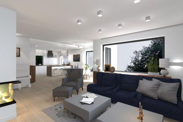 Zobacz jak zaprojektowano nowoczesne wnętrza domu jednorodzinnego łączącego kuchnię z jadalnią oraz salonem. Ponadto pokazany jest projekt dwóch łazienek.