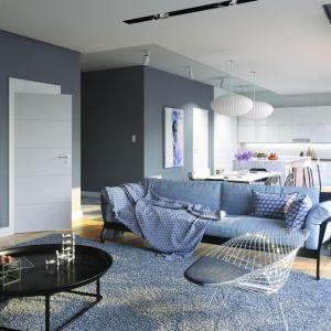 Drzwi Porta Vector Premium, dzięki delikatnym poziomym frezom, dodają nowoczesnego charakteru i wpisują się w łagodny klimat wnętrza. Fot. Porta