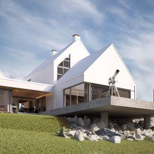 Nawiązanie do zabudowy regionalnej architekt osiągnął dzięki rozbiciu bryły i nadaniu jej kształtu wiejskiej zagrody składającej się z kilku odrębnych części. Fot. Galeco