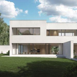 Wielkoformatowe okna i drzwi otwierają wnętrza na otoczenie, dlatego są tak chętnie stosowane przez architektów w modnych projektach domów jednorodzinnych. Fot. Schüco