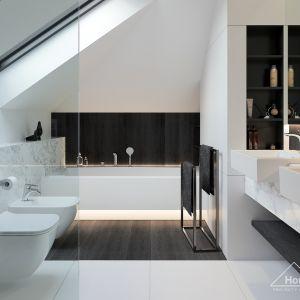 W nowoczesnej łazience dominuje kolor biały, przełamany gdzieniegdzie ciemnymi akcentami. Fot. HomeKONCEPT