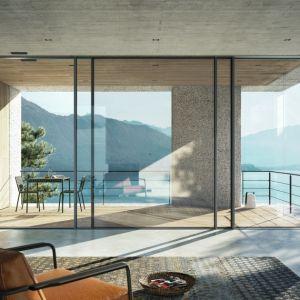 Narożne okna świetnie sprawdzą się w salonach z wyjściem na taras lub stylizowany ganek. Fot. Awilux/Schüco