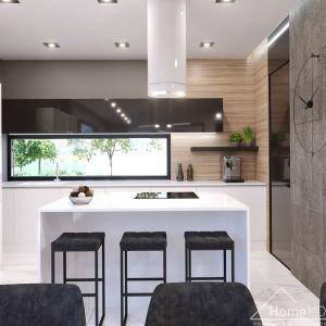 """W kuchni, nad blatem zaprojektowano okno, które """"doświetla"""" miejsce robocze światłem naturalnym. Fot. HomeKONCEPT"""