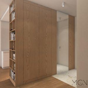 Jedne z drzwi przedpokojowej szafy są nie z fornirowanej drewnem płyty meblowej, tylko z lustra, tak żeby można było przejrzeć się od stóp do głowy. Jego drugim zadaniem jest optyczne poszerzenie wąskiego pomieszczenia. Fot. Pracownia MGN