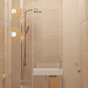 W niewielkim WC na parterze wykorzystano każdy centymetr przestrzeni, dzięki czemu zmieściła się tu kabina prysznicowa, wydzielona z pomieszczenia drzwiami przesuwnymi. Tym sposobem powstała druga łazienka, idealna dla gości. Fot. Pracownia MGN