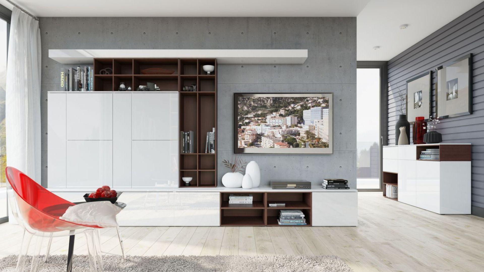 Kolekcja Loft to nowoczesne meble na wysoki połysk, połączone z elementami drewna. Dzięki nim stworzyć ciekawą meblościankę, z dużą ilością miejsca do przechowywania. Fot. Szynaka Meble
