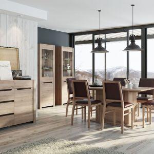 Jasne, naturalne aranżacje lubią drewno. Nowoczesności takiej stylistyce może dodać stół z dużą, grubą nogą. Na zdjęciu kolekcja Desjo. Fot. Szynaka Meble